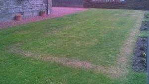 outline of back of WW2 air raid shelter at Troon Old Parish Church, seen on 11 June 2016