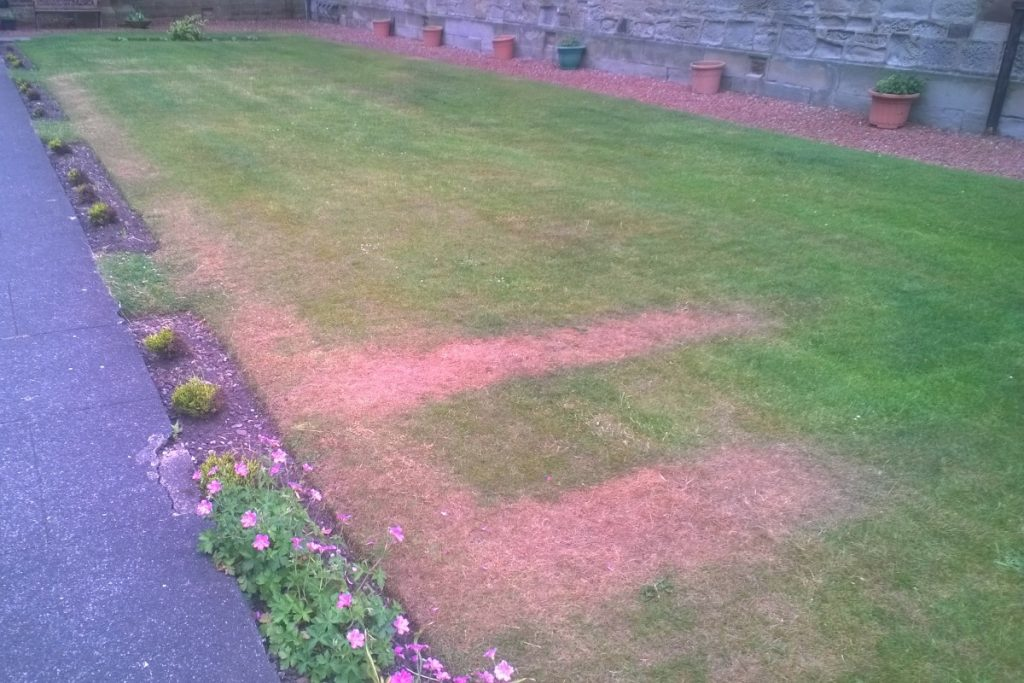 outline of front of WW2 air raid shelter at Troon Old Parish Church, seen on 11 June 2016