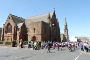 the Glasgow Police Pipe Band lead the Glasgow Taxis parade past Troon Old, June 2013